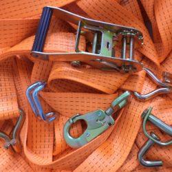 Acessórios para cintas e amarrações de cargas